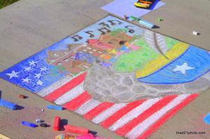 Photo by Brad Cockman/brad21photo.com Sidewalk chalk art at Heritage Park on Thursday.