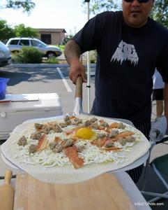 Photo courtesy of Brad Cockman/ www.brad21photo.com Lentine's breakfast pizza at Lampe Park Farmers Market Wednesday morning.