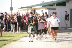 Photo courtesy of Belinda Grant Photography/ www.belindagrantphotography.com Bagpiper Sean Cummings followed by the Carson Valley HotShots and nearly 40 softball teams marched in the opening ceremonies for the Northern Sierra Fastpitch State Tournament