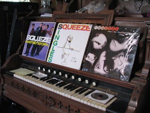 Albums sit on the pump organ in the Wayne family living room.