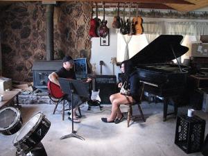 Matt Wayne, left, gives a music lesson to Savannah Simmons, 13, on July 10.