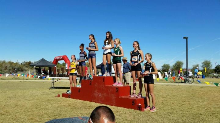 Lindsey Adams atop the medal podium at state cross country Saturday.