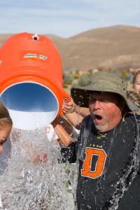 Photo courtesy of Ron Harpin/ www.rahphotosnv.com Douglas soccer coach Werner Christen gets an ice bath after Douglas defeated Galena 1-0 at Damonte Ranch Saturday afternoon.