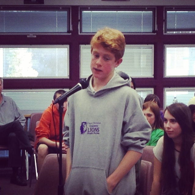 Grace Christian Academy eighth-grader Daniel Taylor spells during the Douglas County School ,District Spelling Bee at Pau-Wa-Lu Middle School in January.