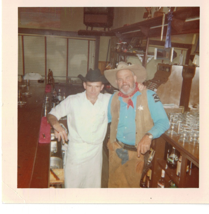 Photo courtesy of the Lekumberry Family Collection  Jean Lekumberry with legendary Sheriff George Byers behind the J.T. Bar, early 1960's