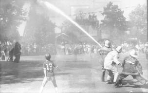 The water fights during Carson Valley Days in Minden Park. Fire crews would blast hoses at a barrel or keg suspended from a cable above in a sort of reverse tug-of-war.
