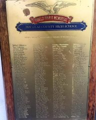 Douglas High teacher Ernie Monfiletto hosts this plaque bearing the names of all the Douglas County High School students who went on to serve in various branches of the military during World War II.